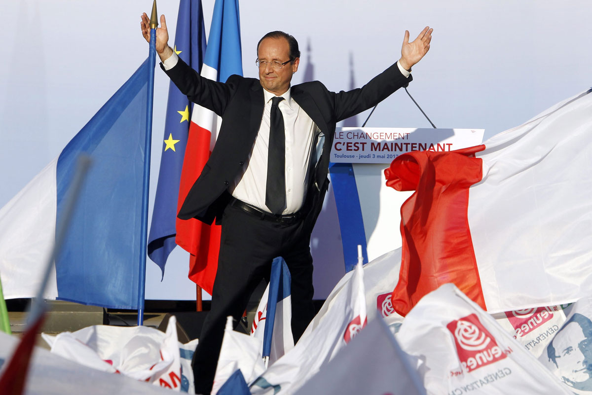 Francois Hollande, French Socialist Party (PS) candidate for the 2012 French presidential election, waves to supporters (AAP)