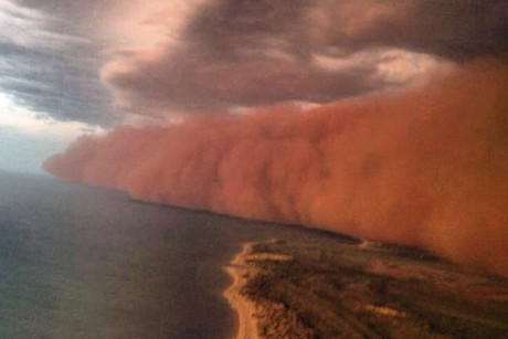 The edge of the storm is seen in this photo taken while flying into Onslow (Photo: Facebook/Perth Weather Live)